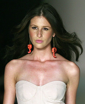 Model presents creation from Teca's 2010 spring/summer collection during Fashion Rio Show in Rio de Janeiro